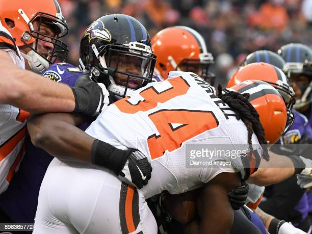 Defensive tackle Michael Pierce of the Baltimore Ravens tackles running back Isaiah Crowell of the Cleveland Browns in the first quarter of a game on...