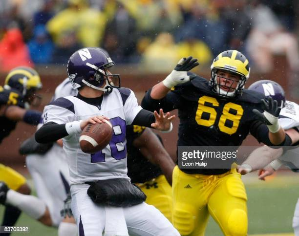 Defensive tackle Mike Martin of the Michigan Wolverines puts the pass rush on quarterback C. J. Bacher of the Northwestern Wildcats in the fourth...