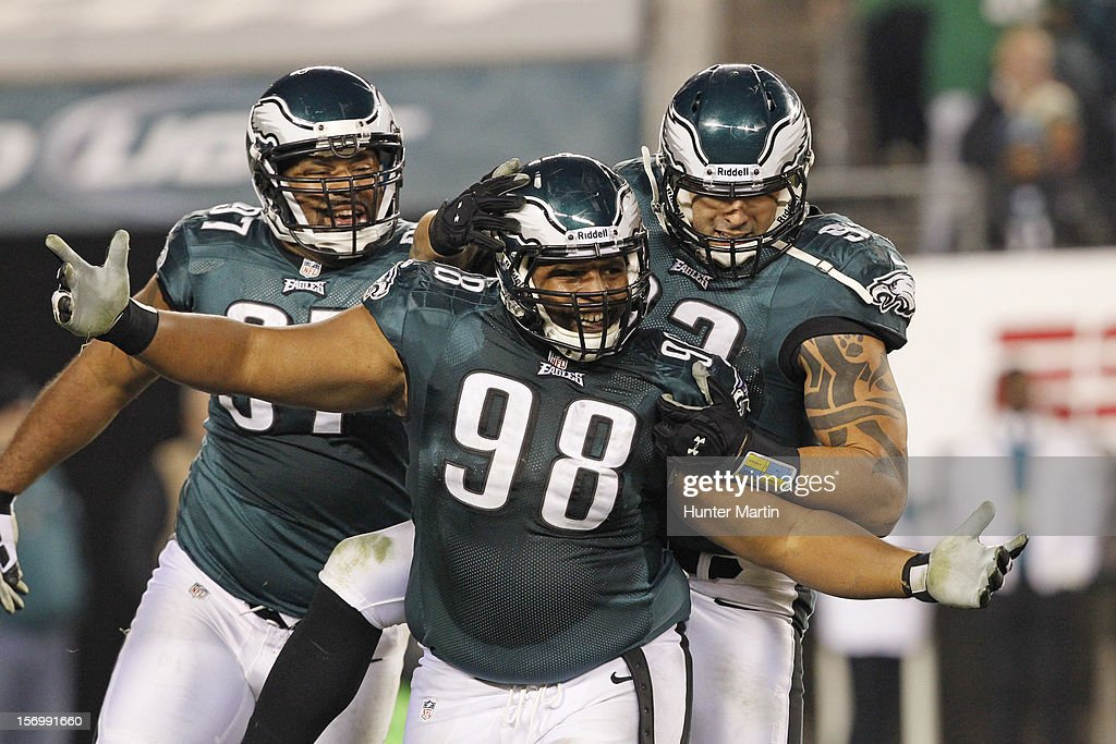 Defensive tackle Mike Patterson #98 of the Philadelphia Eagles celebrates after making a sack during a game against the Carolina Panthers on November 26, 2012 at Lincoln Financial Field in Philadelphia, Pennsylvania. The Panthers won 30-22.