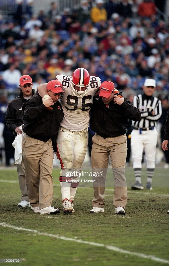 Defensive Tackle Mike Thompson #96 of the Cleveland browns is helped off the playing field after a leg injury during a NFL game against the Baltimore Ravens at PSINet Stadium on November 26, 2000 in Baltimore, Maryland. The Ravens defeated the Browns 44 to 7.