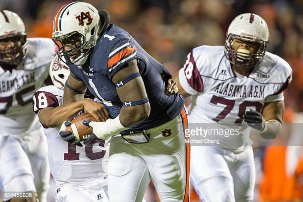 Defensive tackle Montravius Adams of the Auburn Tigers intercepts a pass in front of quarterback De'Angelo Ballard of the Alabama AM Bulldogs at...