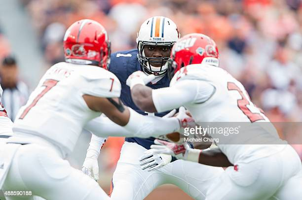 Defensive tackle Montravius Adams of the Auburn Tigers watches quarterback Eli Jenkins of the Jacksonville State Gamecocks hand the ball off to...