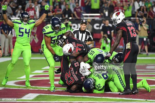 Defensive tackle Nazair Jones of the Seattle Seahawks tackles running back Adrian Peterson of the Arizona Cardinals in the end zone for a safety in...
