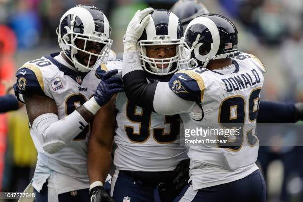 Defensive tackle Ndamukong Suh of the Los Angeles Rams celebrates a sack with teammates in the second half against the Seattle Seahawks at...