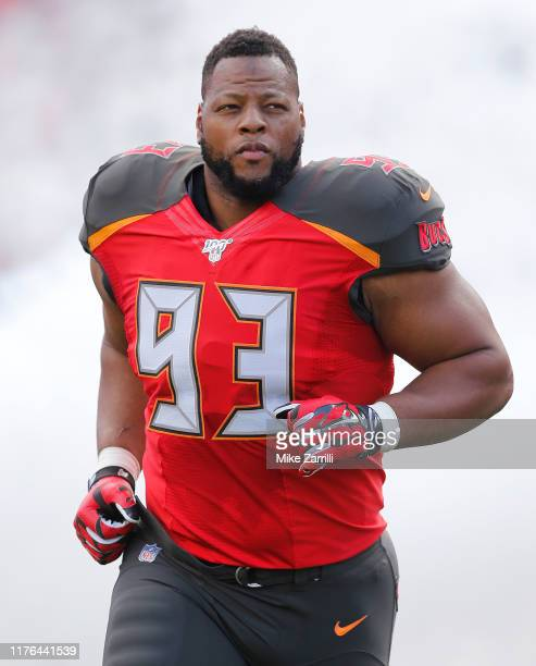 Defensive tackle Ndamukong Suh of the Tampa Bay Buccaneers runs on the field during pregame introductions before the game against the New York Giants...