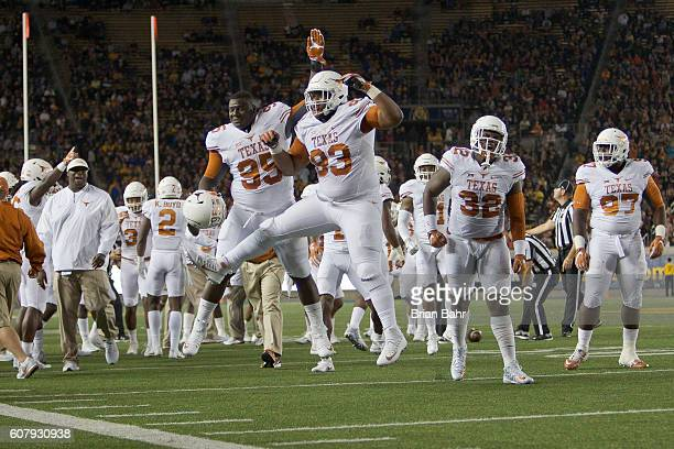 Defensive tackle Paul Boyette Jr #93 and defensive tackle Poona Ford of the Texas Longhorns celebrate stopping the California Golden Bears on fourth...
