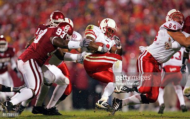 Defensive tackle Remi Ayodele of the Oklahoma Sooners tackles Cory Ross of the Nebraska Cornhuskers on November 13 2004 at Memorial Stadium in Norman...
