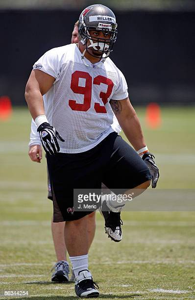 Defensive tackle Roy Miller of the Tampa Bay Buccaneers stretches during the Buccaneers Rookie Minicamp at One Buccaneer Place on May 1 2009 in Tampa...