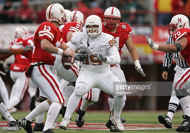 Defensive tackle Roy Miller of the Texas Longhorns pressures quarterback Zac Taylor of the Nebraska Cornhuskers during the game against on October 21...