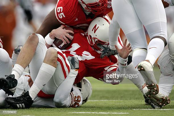 Defensive tackle Roy Miller of the Texas Longhorns sacks quarterback Zac Taylor of the Nebraska Cornhuskers on October 21 2006 at Memorial Stadium in...