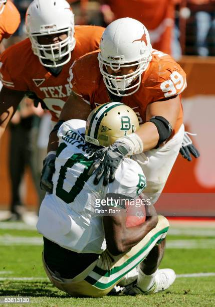 Defensive tackle Roy Miller of the Texas Longhorns sacks quarterback Robert Griffin of the Baylor Bears in the second quarter on November 8 2008 at...