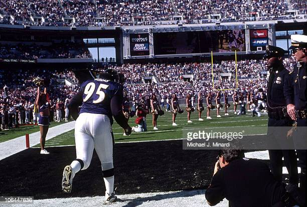 Defensive Tackle Sam Adams of the Baltimore Ravens runs onto the field before the beginning of a NFL game against the Tennessee Titans at PSINet...