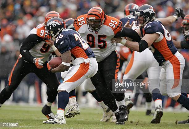 Defensive tackle Sam Adams of the Cincinnati Bengals closes in on running back Tatum Bell of the Denver Broncos on December 24 2006 at Invesco Field...