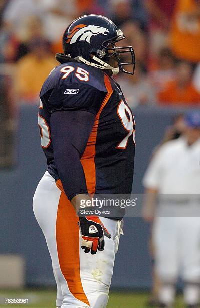 Defensive tackle Sam Adams of the Denver Broncos waits at the line of scrimmage during the preseason football game against the Cleveland Browns on...