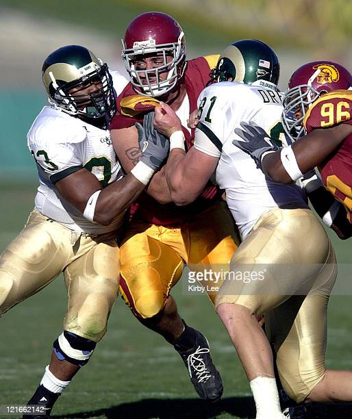 Defensive tackle Shaun Cody is defended by Michael Brisiel and Joel Dreesen of Colorado State during the first quarter of USC's 49-0 victory at the...