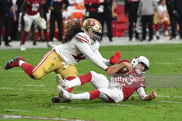 Defensive tackle Sheldon Day of the San Francisco 49ers tackles quarterback Josh Rosen of the Arizona Cardinals during the third quarter at State...