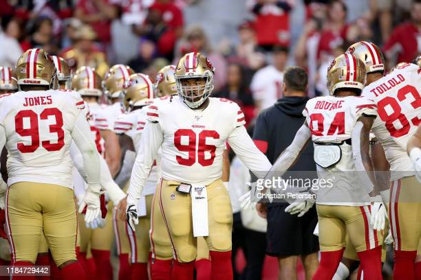 Defensive tackle Sheldon Day of the San Francisco 49ers walks on to the field before the game against the Arizona Cardinals at State Farm Stadium on...