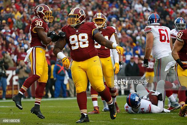 Defensive tackle Terrance Knighton of the Washington Redskins and strong safety Kyshoen Jarrett of the Washington Redskins react after a play while...