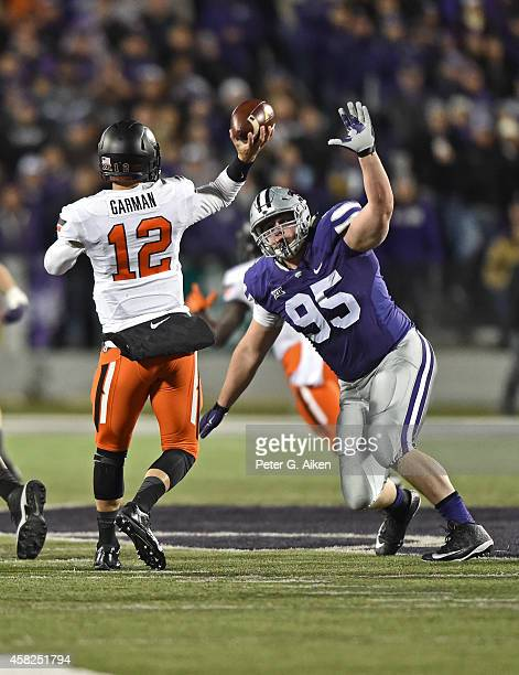 Defensive tackle Travis Britz of the Kansas State Wildcats pressures quarterback Daxx Garman of the Oklahoma State Cowboys during the first half on...