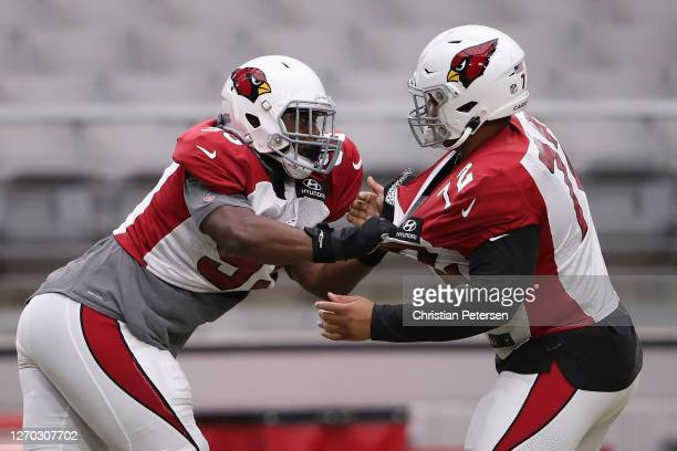 Defensive tackle Trevon Coley of the Arizona Cardinals works on drills with defensive tackle Miles Brown during a NFL team training camp at State...