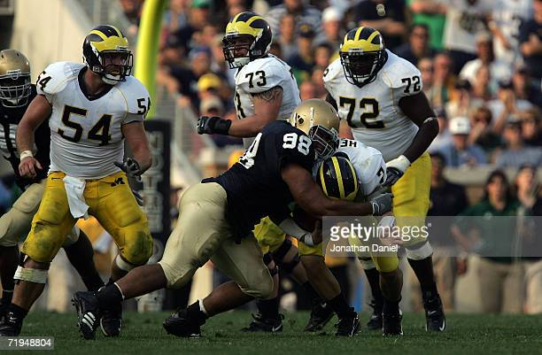 Defensive tackle Trevor Laws of the Notre Dame Fighting Irish sacks quarterback CHad Henne of the Michigan Wolverines September 16, 2006 at Notre...