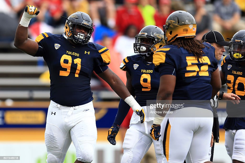 Defensive tackle Treyvon Hester #91 of the Toledo Rockets celebrates a sack against Fresno State Bulldogs during the second quarter at Glass Bowl on September 17, 2016 in Toledo, Ohio.
