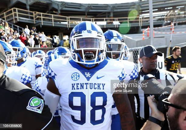 Defensive tackle Tymere Dubose of the Kentucky Wildcats yells as he prepares to run out of the tunnel onto the field ahead of the game against the...