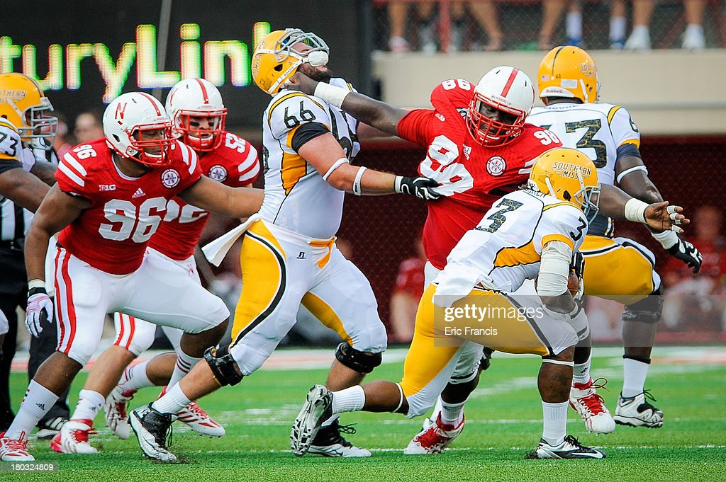 Defensive Tackle Vincent Valentine Of The Nebraska Cornhuskers Reaches For  Running Back Tyre Bracken Of The