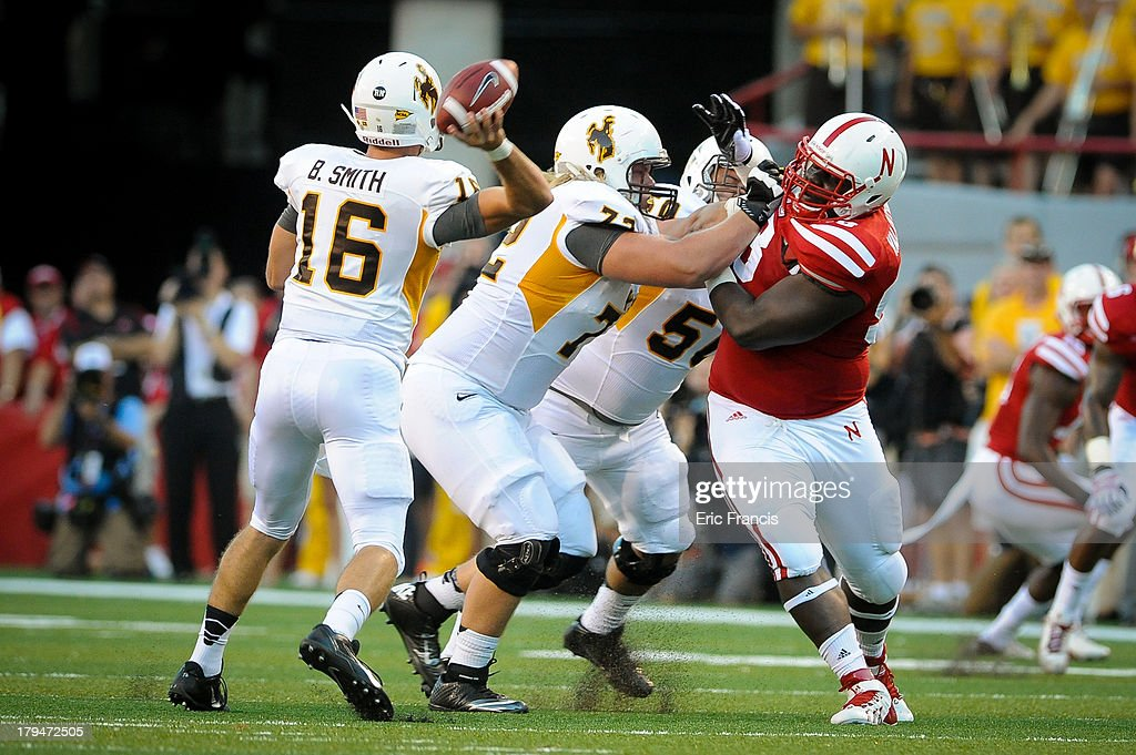 Defensive Tackle Vincent Valentine Of The Nebraska Cornhuskers Tries To Get  To Quarterback Brett Smith Of
