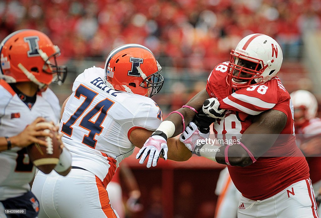 Defensive Tackle Vincent Valentine Of The Nebraska Cornhuskers Tries To  Break Free From Offensive Linesman Michael