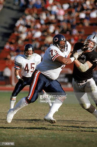 Defensive tackle William Perry of the Chicago Bears battles against center Don Mosebar of the Los Angeles Raiders at the Los Angeles Memorial...