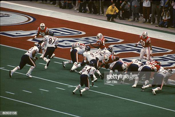 Defensive tackle William The Refrigerator Perry of the Chicago Bears scores a touchdown against the New England Patriots in Super Bowl XX at the...
