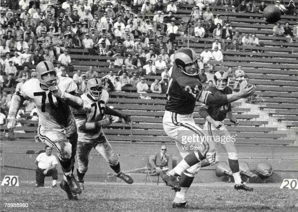 """Defensive tackles Ernie Stautner and Eugene """"Big Daddy"""" Lipscomb of the Pittsburgh Steelers look to cover on a pass play in a 20 to 13 win over the..."""
