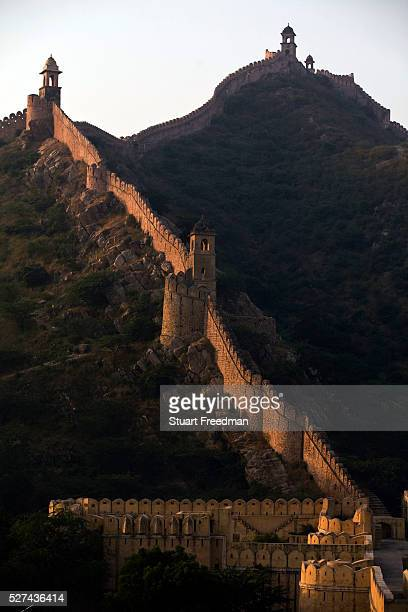 Defensive wall and battlements around the Amber Palace Jaipur India The Amer Fort was built over the remnants of an earlier structure during the...