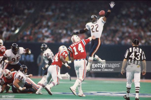 Defensiveback Dave Duerson of the Chicago Bears leaps to try to block the pass of quarterback Steve Grogan of the New England Patriots during Super...
