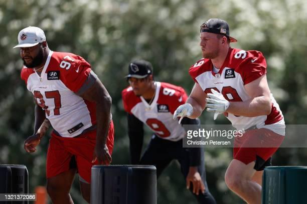 Defensive-line Jordan Phillips and J.J. Watt of the Arizona Cardinals participate in an off-season workout at Dignity Health Arizona Cardinals...
