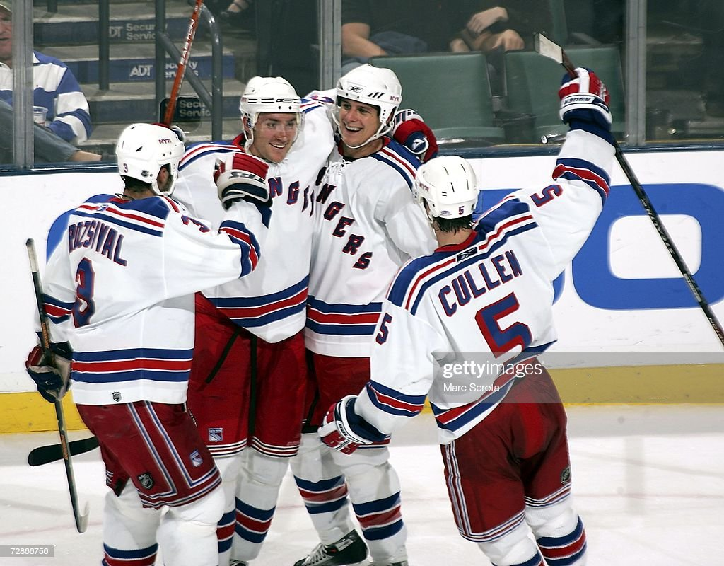 Defensman Karel Rachunek #23 of the New York Rangers celebrates scoring a goal against the Florida Panthers with teammates Michal Rozsival #3, Matt Cullen #5 and Brad Isbister #15 at the BankAtlantic Center December 21, 2006 in Sunrise, Florida.