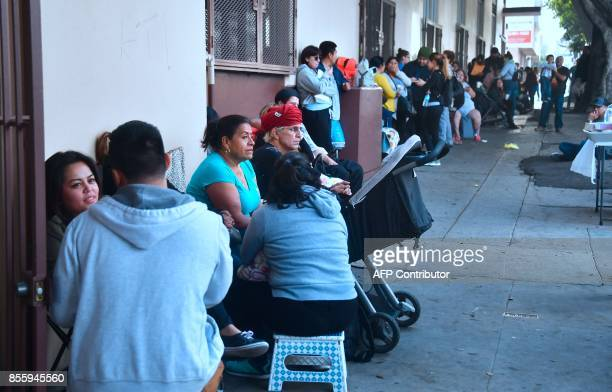 Deferred Action for Childhood Arrivals recipients wait in line at the Coalition for Humane Immigrant Rights office in Los Angeles on September 30...