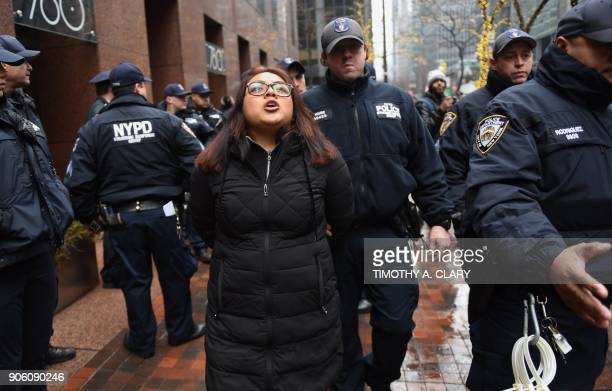 A Deferred Action for Childhood holder is arrested by the New York Police Department as she and a group of amnesty Dreamer protesters staged a sitin...
