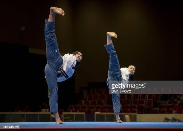 TOPSHOT Defia Rosmaniar of Indonesia competes against Khim Wen Yap of Malaysia during the taekwondo women's individual poomsae final at a test event...