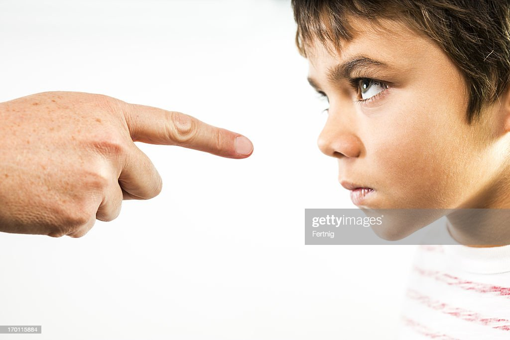 Defiant child being disciplined. : Stock Photo