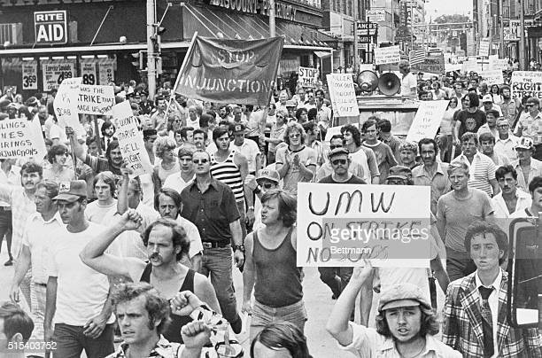 Defiant coal miners of the UMW demonstrate in the streets of Charleston West Virginia during a wildcat strike in support of the removal of...