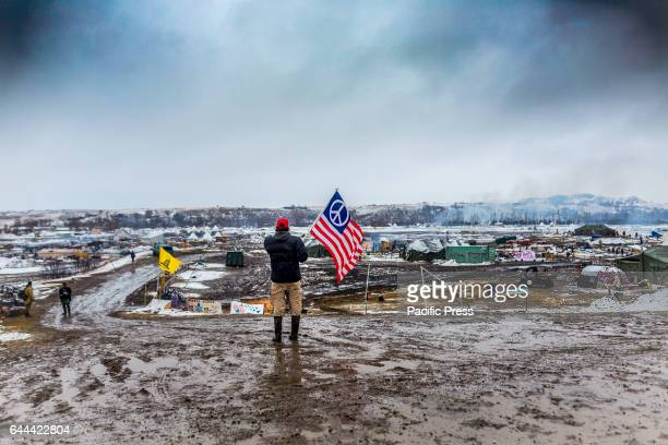 Defiant Dakota Access Pipeline water protectors facedoff with various law enforcement agencies on the day the camp was slated to be raided Many...