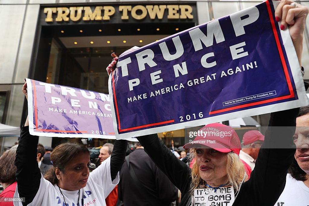 Defiant Donald Trump supporters gather outside of Trump Towers in Manhattan October 8, 2016 in New York City. The Donald Trump campaign has faced numerous calls for him to step aside after a recording from 2005 revealed lewd comments Trump made about women.