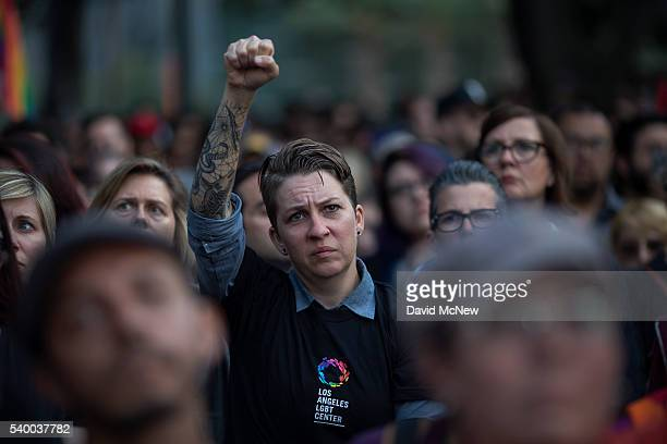 Defiant fist is raised at a vigil for the worst mass shooing in United States history on June 13, 2016 in Los Angeles, United States. A gunman killed...