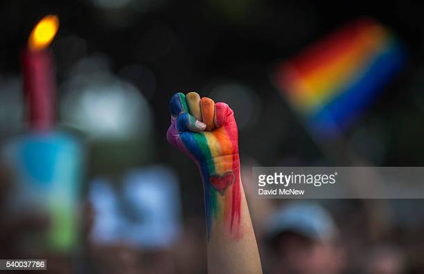 A defiant fist is raised at a vigil for the worst mass shooing in United States history on June 13 2016 in Los Angeles United States A gunman killed...
