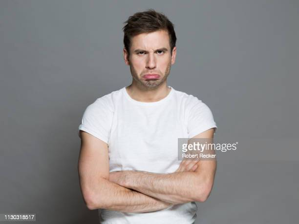 defiant young man - disappointment stock pictures, royalty-free photos & images