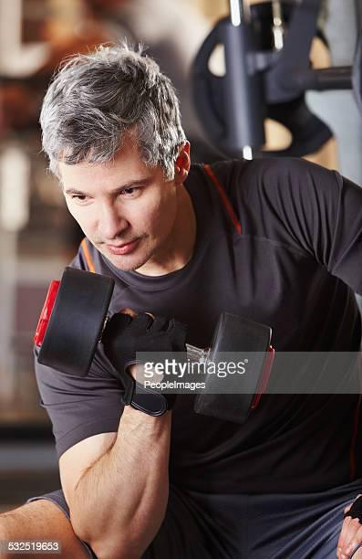 Defining his biceps