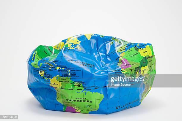 A deflated globe beach ball