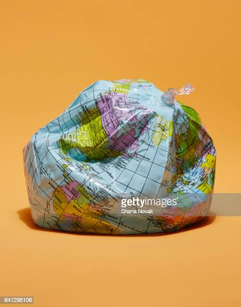 deflated globe - club international stock photos and pictures